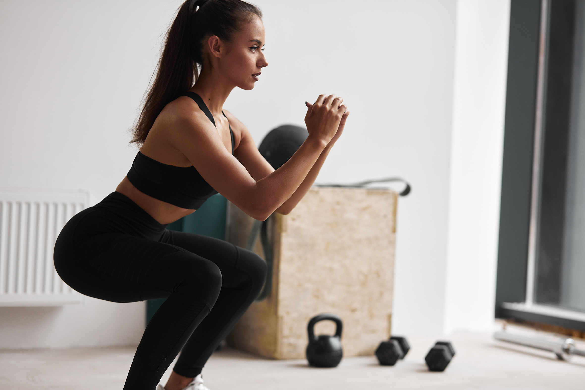 Squats by fit beautiful woman